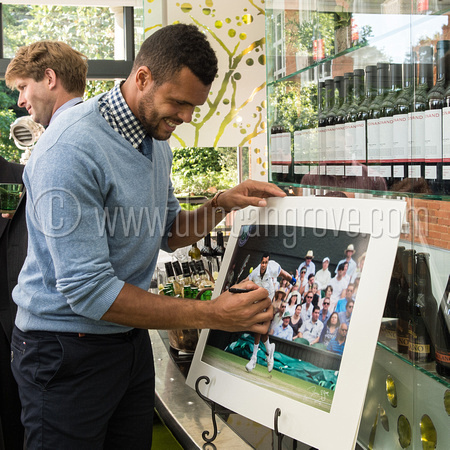 Jo-Wilfried Tsonga signs one of Duncan