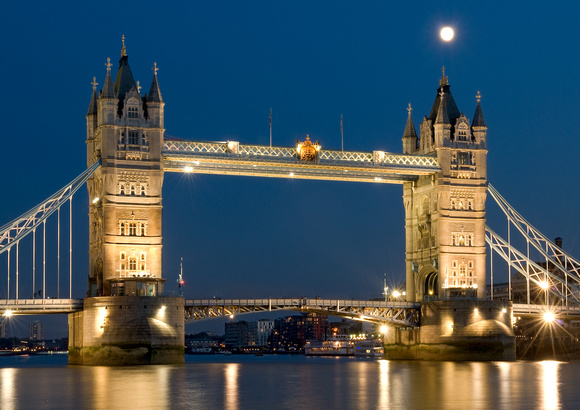 Tower Bridge at Dusk with moon and reflections.